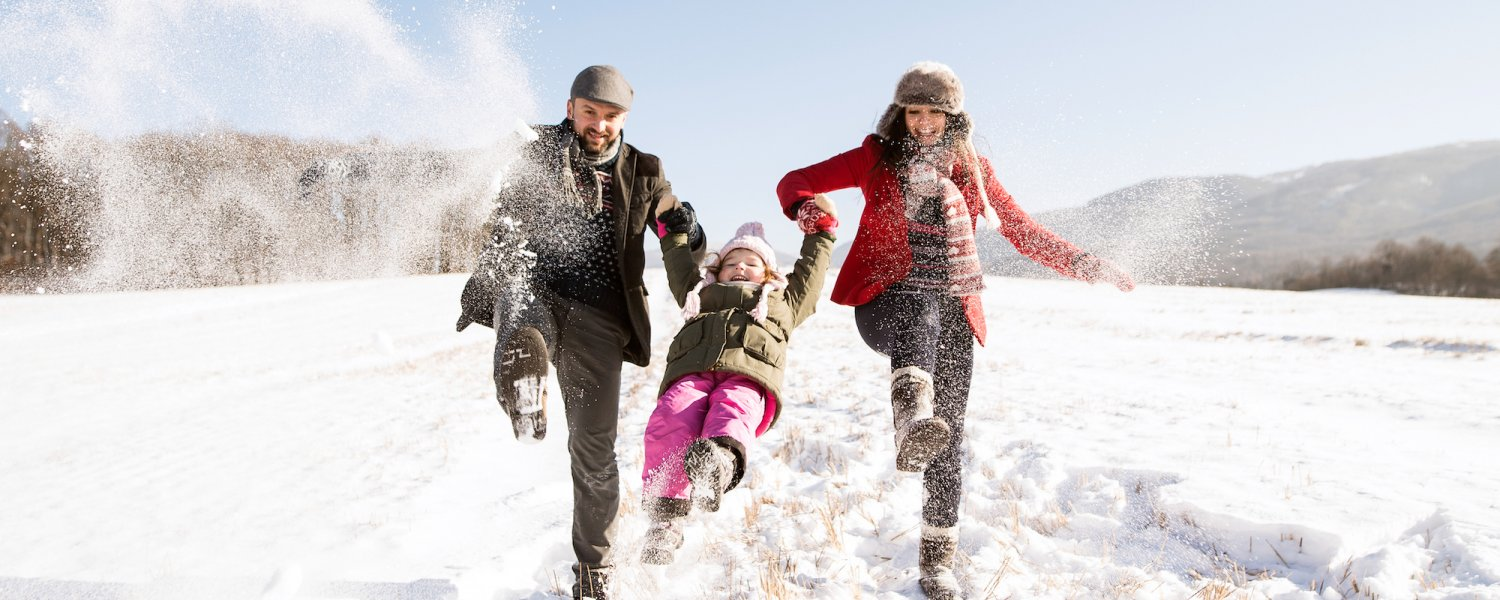 Father And Mother With Their Daughter Playing In The Snow 865003508 4799X3194 1